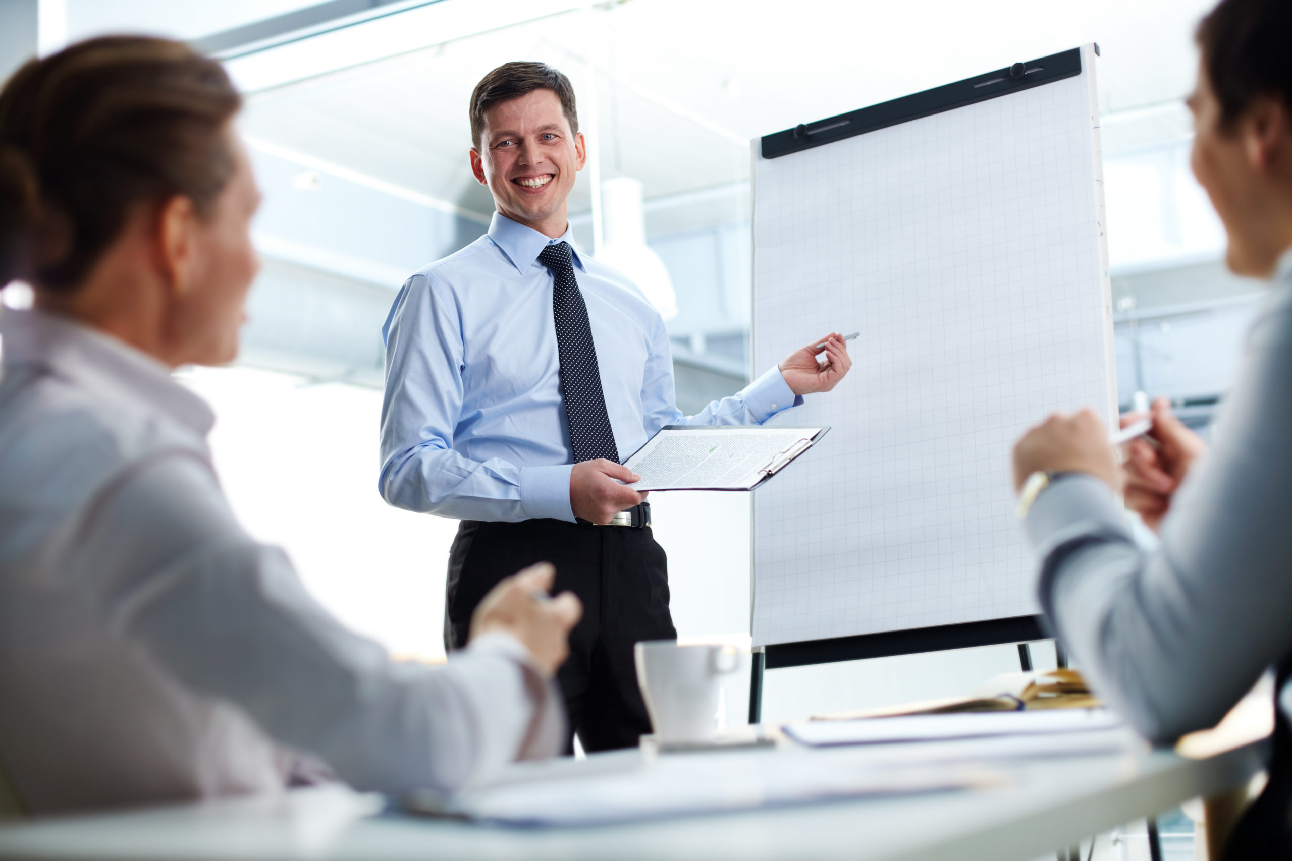 Cheerful businessman discussing a new business project with the members of his team